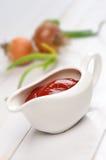 Bateau de sauce au jus Photographie stock