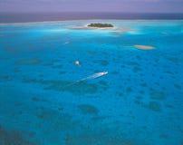 Bateau et île image libre de droits