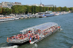 Bateau Mouche on the Seine river in Paris Stock Photography