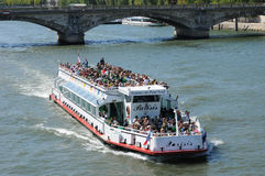 Bateau Mouche on the Seine river in Paris Stock Photos
