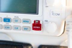 Bateau rouge de bateau de radio de bouton d'aide de détresse photo libre de droits