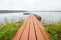 Bateaux à rames et dock Photographie stock