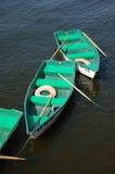 Bateaux avec des avirons Photographie stock