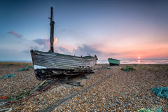 Bateaux de pêche au lever de soleil Photo stock