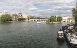 Bateaux Mouches boats cruising the Seine river in Paris stock photo