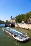 Bateaux - mouches in the Sena river. A Bateau Mouche - excursion boat on the Seine Stock Images