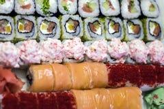 Batedor do sushi no fundo da tabela fotografia de stock