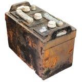 Batería de coche vieja oxidada aislada en blanco Fotografía de archivo libre de regalías