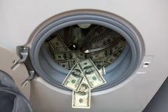 Batería de dólares en lavadora Fotografía de archivo libre de regalías