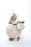 Batería de moneda de las ovejas con los dólares australianos imagen de archivo libre de regalías