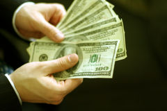 Batería del dinero imagen de archivo libre de regalías