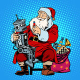 Batería del robot del regalo de Santa Claus Fotografía de archivo libre de regalías