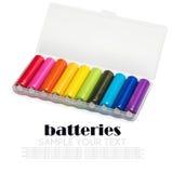 Baterías de diversos colores en una caja Fotografía de archivo libre de regalías