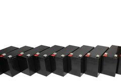 Baterías de plomo selladas en el fondo blanco Fotos de archivo libres de regalías