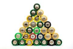 Baterías del AA en un pyramide aisladas Imágenes de archivo libres de regalías