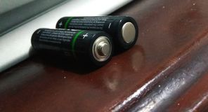 Bateria AA plus minus i obraz royalty free