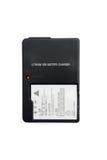 Bateria recarregável e carregador Fotografia de Stock Royalty Free