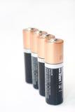 Baterias alcalinas alinhadas estando do AA Fotografia de Stock Royalty Free