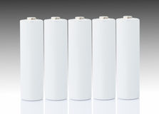 Baterias do AA sobre o branco Fotografia de Stock Royalty Free