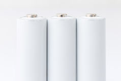 Baterias do AA sobre o branco Imagens de Stock