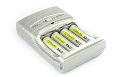 Baterias e carregador Fotografia de Stock