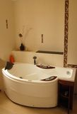 Bath. Large luxury bath with shower in the evening Royalty Free Stock Images