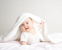 After bath. Little baby under white  towel Royalty Free Stock Photography