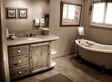 Bath. Room with clawfoot tub in sepia Royalty Free Stock Photos