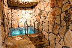 Bath. Luxurious bathtub with stone wall Royalty Free Stock Photo
