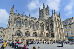 Bath Abbey in the City of Bath in Somerset England. Bath, UK - May 13, 2016: Tourists and locals gather in the courtyard of the historic Bath Abbey and Roman Royalty Free Stock Images