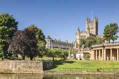 Bath Abbey and River Avon Somerset UK. Bath Abbey and the Orangerie on the banks of the River Avon, on a beautiful summer morning with perfectly clear blue sky Royalty Free Stock Photography