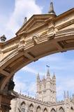 Bath Abbey under a Palladian Bridge. Bath Abbey Framed by a Beautiful Palladian Bridge on York Street in Bath England Royalty Free Stock Photography