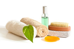 Bath accessories. Spa accessories with green leaf on a light background Stock Images