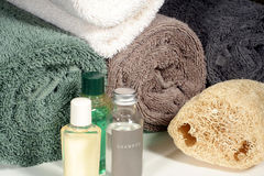 Bath Accessories. This is an image of shower amenities with rolled bath towels stock images