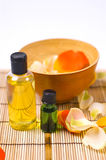 Bath accessories. Flower petals, bowl and oils - bath accessories stock photo