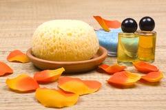 Bath accessories. Shower gel, sponge, flower petals and bath salt  - bath accessories Royalty Free Stock Photos