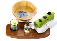 Bath accessories with aroma oils. Spa towels with aroma oils and wooden bowl isolated on white Royalty Free Stock Photos