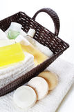 Bath accessories in basket, still life. Bath accessories, soaps bars and soft towels in basket, still life Stock Photo