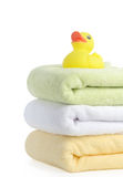 Bath accessories. Bath towels. And Yellow rubber duckies Royalty Free Stock Photography
