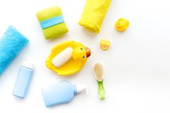Bath accessories for kids. Yellow rubber duck, soap, sponge, brushes, towel on white background top view copyspace Royalty Free Stock Photos