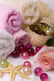 Bath accessories and rose. Various items for bath towels oil pearls sponge and pink rose Royalty Free Stock Photo