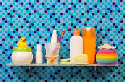 Bath accessories on shelf Stock Images