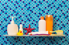 Bath accessories on shelf Royalty Free Stock Image