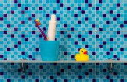 Bath accessories on shelf Stock Image