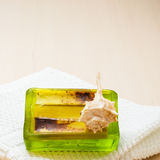 Bath accessories towel and green bar soap Royalty Free Stock Photos