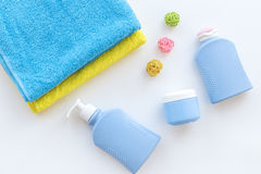 Bath accessories. Towels, soap, shampoo, lotion, cream on white background top view Stock Photo