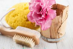 Bath accessories on white wooden table Stock Photos