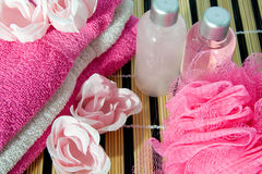 Bath accessory. Pink colored bath accessory on cane mat royalty free stock image