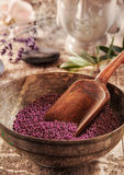 Bath additive beads in a wooden bowl Stock Photo
