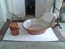 Bath anyone?. This photo shows an old tin bath from bygone days at Standen House in Sussex stock photo